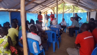 Simon meeting the community in Yumbe
